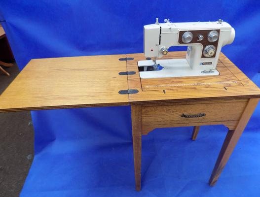 New Home sewing machine in folding table