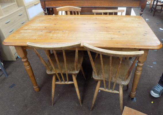 Pine table and four Ercol style chairs