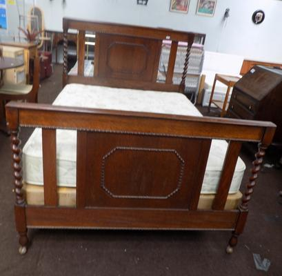 Vintage double bed with decorative headboard and base