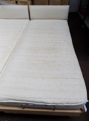 Single electric bed in working order with scorch marks on mattress