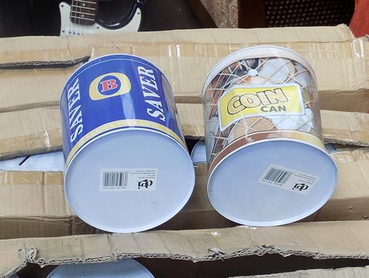 3 boxes of money tins - some dinted