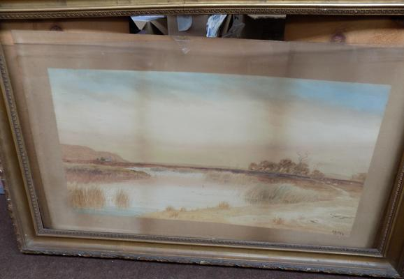 Framed picture of lake scene signed by artist. In need of re framing