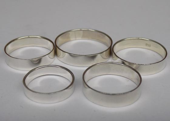 Five solid 925 silver wedding band rings, various sizes