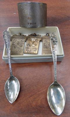 Two silver spoons, silver napkin ring & three medals by Sweet Pea Society
