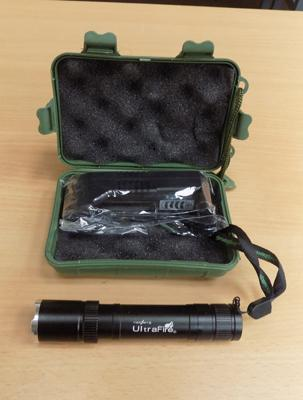 Brand new Ultra Fire torch with rechargable battery & charger