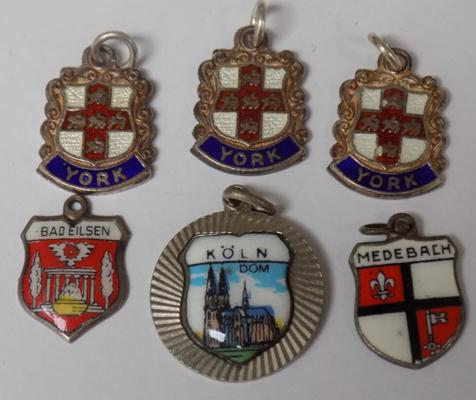 Selection of vintage silver, 800 silver, enamel shields