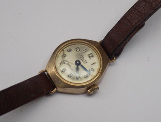 9ct  Gold Majex watch with leather strap (ticking)