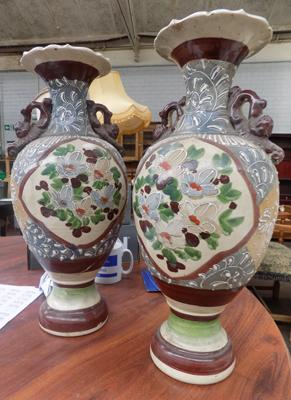 Two large stone urns - some damage