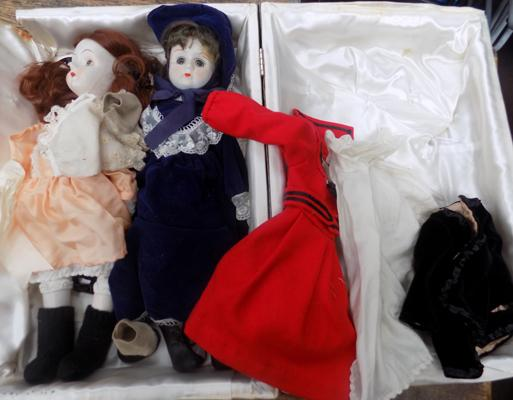 Two vintage china headed dolls in lined presentation case + lace clothing