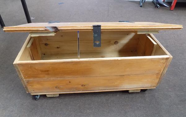 Wooden chest on wheels