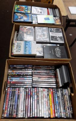 Three boxes of DVDs
