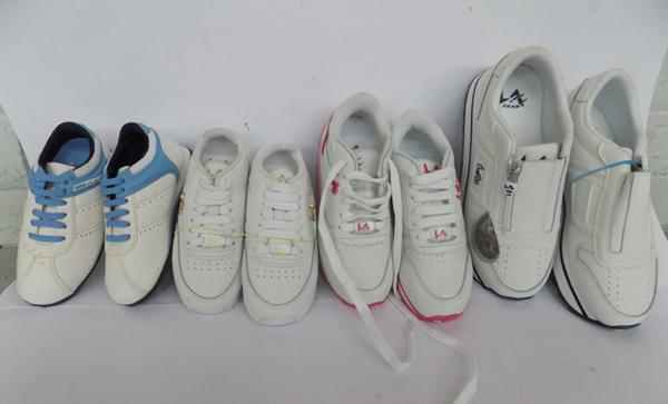 Box of four pairs of new kids trainers