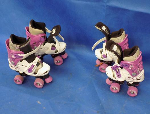 Two pairs of girl's roller boots, almost new, adjustable sizes
