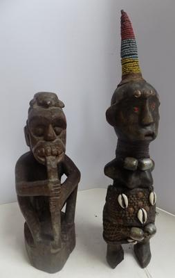 "2 small hand carved wooden tribal figures. Approx 11"" high"