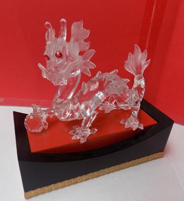 Swarovski crystal mythical dragon with frosted mane & tail with red eyes on plinth-no damage