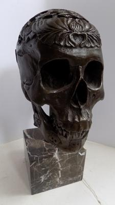 Bronze Buddhist Nambala skull on marble base