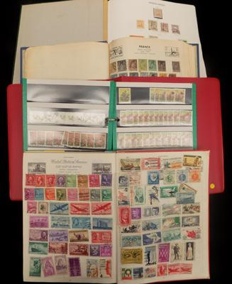 4 well filled albums of World stamps