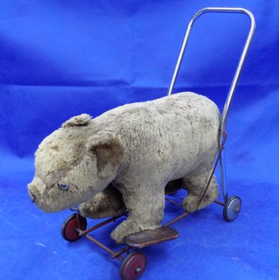 Vintage child's push along bear