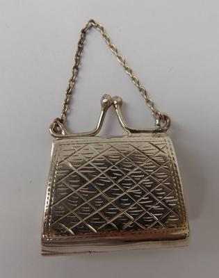 Solid silver miniature purse-very good condition approx 1.5""
