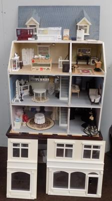 Beautifully furnished dolls house/ shop with furniture accessories etc.
