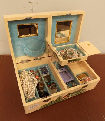 Musical jewellery box filled with costume jewellery