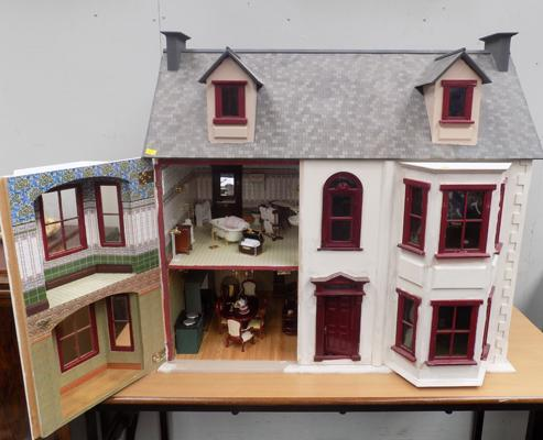 Beautifully furnished large dolls house with large selection of furniture etc.