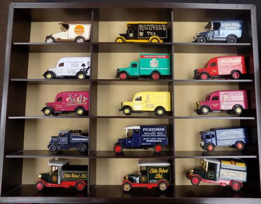 Collectable advertising vans in cabinet