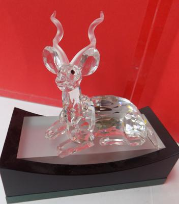 "Swarovski crystal Kudu lying, clear Kudu frosted antlers approx 4"" long on plinth-no damage"