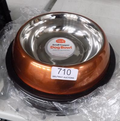 Ten copper dog bowls
