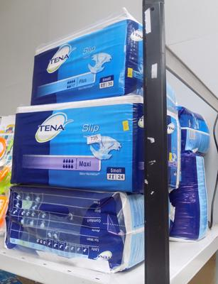Eight packs of Tena pads