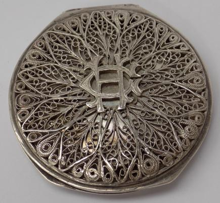 "White metal compact 2.5"" diameter"