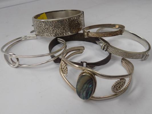 Solid silver and sterling silver christening bangle and 4 white metal bangles