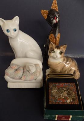 Collection of four ceramic cats, incl Staffordshire & coasters
