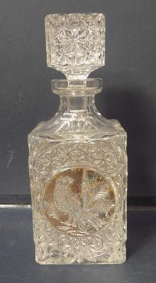 Ornate crystal decanter with bird inlay
