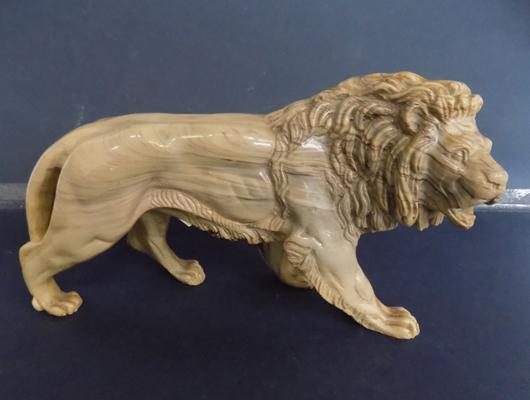 Resin lion figure (approx 10 inch by 3 inch)