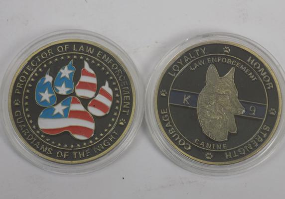 Two collectable coins - loyalty, honour, courage & strength themed
