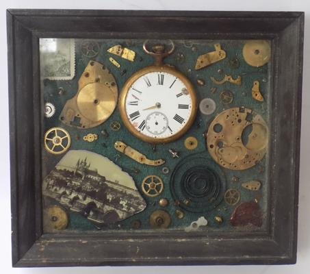 Cased display of clockworks - Approx 7 inch x 6 inch
