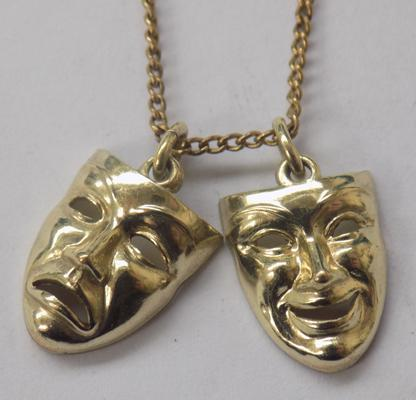 9ct gold chain with 2 9ct gold face pendants