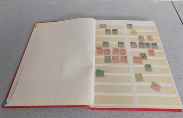 Stock-book of early Canadian stamps etc