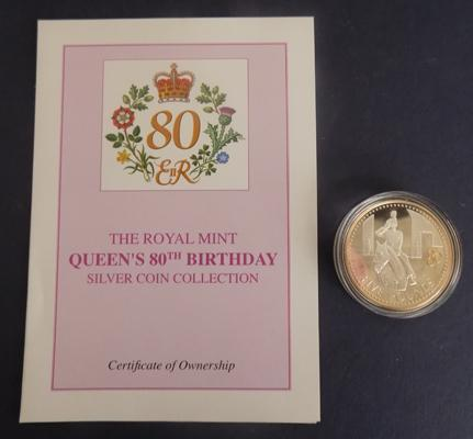 Silver proof £5 coin with COA
