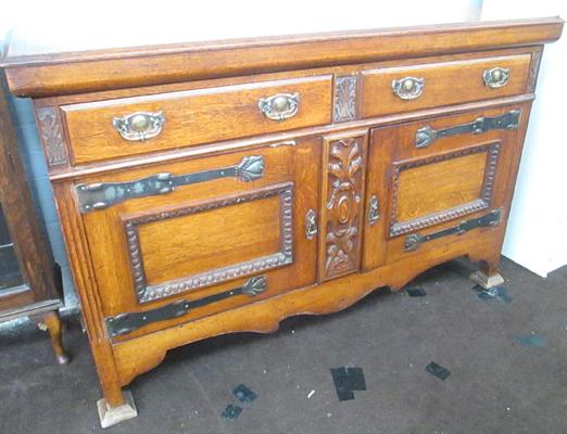 Oak sideboard with carved front