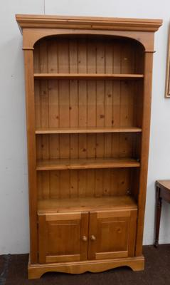 Pine bookcase with lower cupboard & light