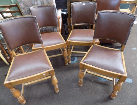 Four leather topped dining chairs
