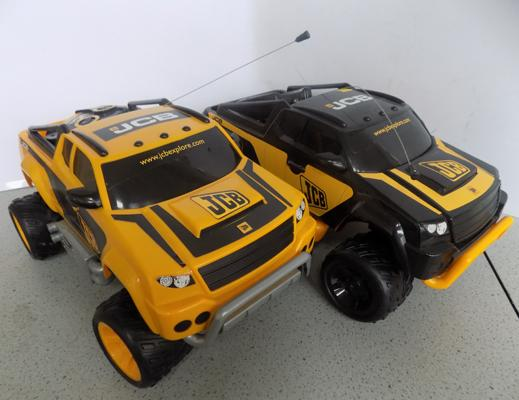 Two JCB radio controlled cars