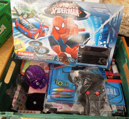 Box of new items with Spiderman racer