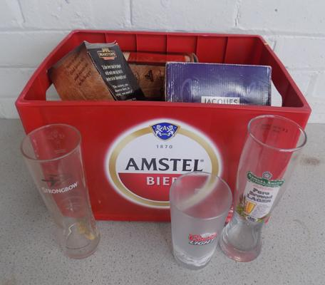 Amstel beer crate and boxed beer glasses plus some lose