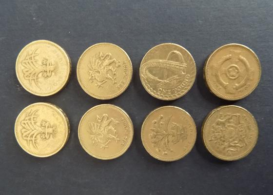 Eight old £1 coins