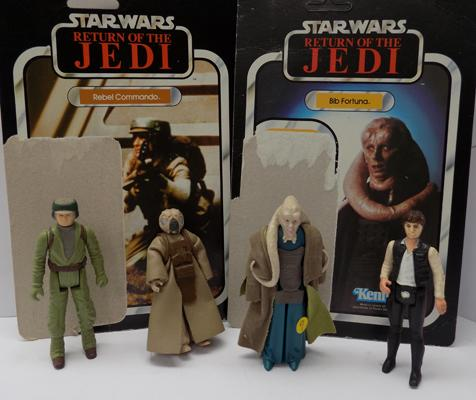 4 Star Wars figures with backing cards