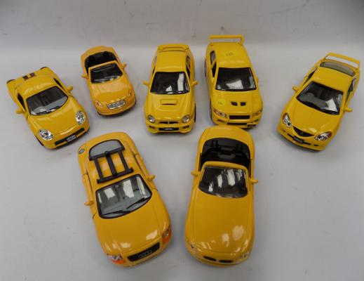 Seven precision diecast cars - as new - 1/32
