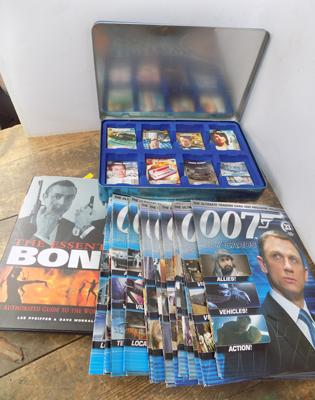 007 James Bond tin of trading cards, 32 magazines, poster and Bond book